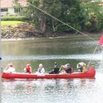 Queen in canoe